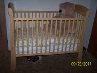SELLING NEW CRIB IN OAK COLOR, BOUGHT BUT NEVER BEEN