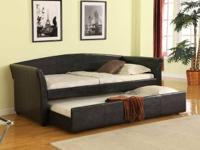 Beautiful upholstered daybed with trundle is set to