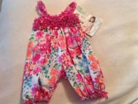 New With tags! Lots of frills and bows! This would be
