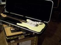 THIS IS A NEW FENDER SQUIRE STRAT WITH A TKL HARDSHELL