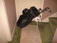 Brand new collegiate golf bag with built in stand. Only
