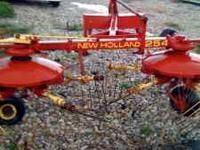 Used New Holland 254 Hay teader/rake combo in great