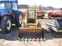 For sale is a new holland 425 skid loader, w/ standerd