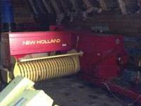 For sale is a 2000 New Holland 570 Kicker Baler with