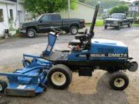 For sale is a ford new holland cm274 commercial front