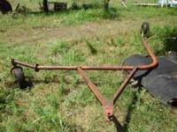 Hay rake dolly used to pull 2 new holland side delivery