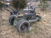 FOR SALE IS A NEW HOLLAND LAWN TRACTOR. REAR TIRES NOT