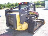 2005 NEW HOLLAND TRACK SKID STEER WITH BUCKET. 1025