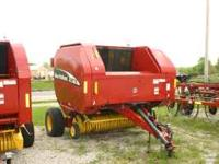 2003 baler model BR770, makes 5 by 5 roll! Execellent