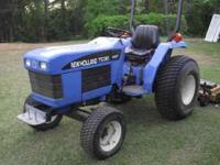 2004 NH TC30 Tractor. It has 3cyl diesel with a