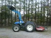 New Holand TN65 tractor with a New Holland 32LA