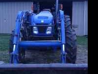 This is a New Holland TN-75A 4 wheel drive tractor with