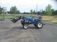 New Holland TC24DA Diesel Tractor with Loader. Only 209