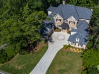 New price! 4685 Lake Forrest Drive is a new estate home
