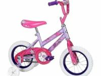 "This 12"" woman's bike features an enjoyable pink color"