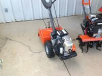 "New Husqvarna rear tine 17"" tiller with Honda engine."