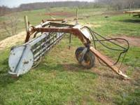 New idea hydraulic hay rake with dolly wheel. works