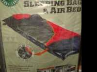 I HAVE A NEW STILL IN THE BOX OZARK TRAIL SLEEPING BAG