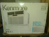 by Kenmore 12000 btus Will cool a whole floor nice AC