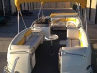 "AND CUSTOM INTERIOR. J.C.'S CLASSIC ""U""-SHAPED PONTOON"