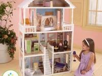 This is a NEW dollhouse and comes with many