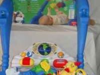 One leapstart learning gym, with misallanus baby toys.