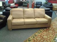 "This is a 86"" three seat sofa made in a mushroom color"