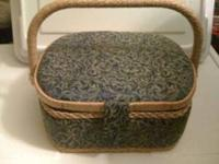 Lidded sewing basket, pictured below. Filled with