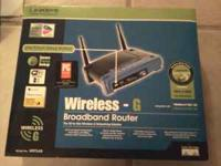 New Linksys wireless (G) 2.4GHZ WIFI BROADBAND ROUTER.