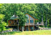 Truly one of a kind home! This 120 acre recreational