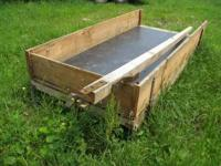 New long sleigh with poly liner on floor. $175. call