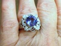 I have a brand new stunning natural Tanzanite, with