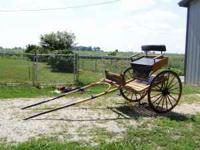 Beautiful showy new oak Easy Entry horse size cart.