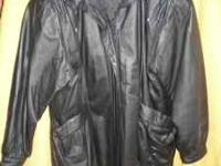 This is a black Liz Baker 3/4 length leather coat in a