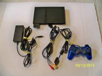PS2 console used 5 times. Like New. With dual shock