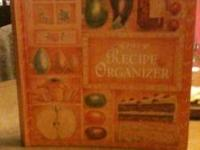 Brand new recipe organizer book. Has blank pages for