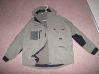 Never been worn Redington jacket. Fleece liner matches