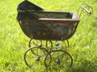 THIS IS A LARGE, TOY-SIZE PRAM TO STROLL AROUND WITH