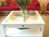 We have a stunning shabby chic white coffee table