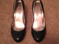 I have a pair of black high heels, size 8, they are in