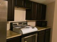 Side by Side Refrigerator, electric stove, dishwasher,