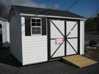 New leonard storage building, vinyl siding, wood frame,