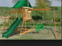 This is a brand new cedar swing set. Never been put