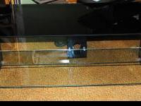 This is a new Ateca tempered glass TV stand made in
