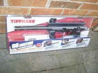 My grandson has for sale a New Tippmann 98 Custom
