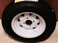 New tire and rim for small trailer or lawn mower. $40.