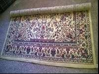I'm selling this new Athena area rug, made by