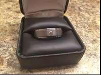 Brand new 7mm tungsten carbide ring with .05ct diamond