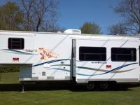 2003 3158PX3 33ft New Vision fifth wheel by KZ. This