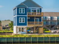 New single family waterfront home in Queens Grant
